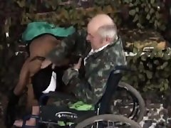 Nurse enjoys riding handicapped old guy in wheelchair