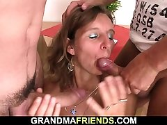 Hairy aged mature woman swallows two penises at once