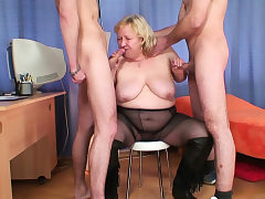 Busty light-haired old grandma swallows 2 cocks
