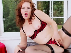 Red-haired gal bellows while she masturbates