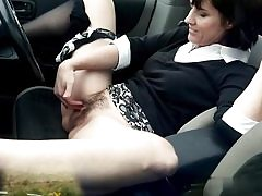 Filthy mature mega-slut fingers her vulva hole on the back seat of her camper